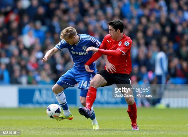Chelsea's Andre Schurrle and Cardiff City's Peter Whittingham battle for the ball