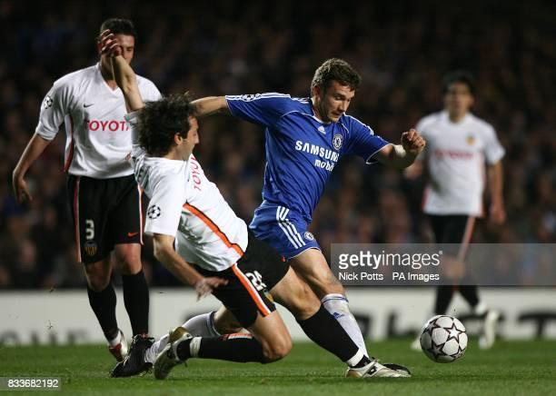 Chelsea's Andriy Shevchenko and Valencia's Emiliano Moretti battle for the ball