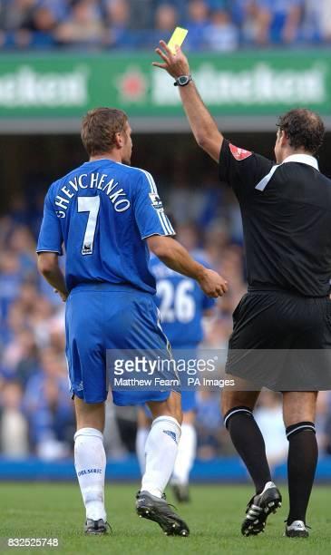 Chelsea's Andriy Shevchenko is booked by Mark Clattenburg