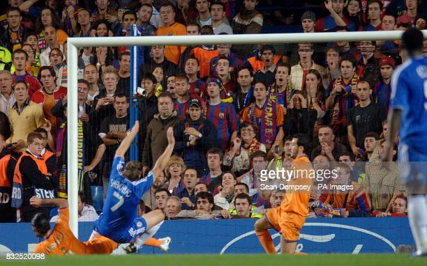 Chelsea's Andriy Shevchenko is tackled by Barcelona's Rafael Marquez