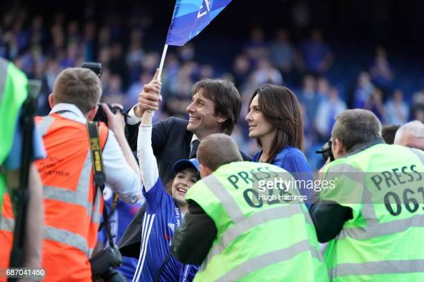 Chelsea's Antonio Conte and his wife after the Premier League match between Chelsea and Sunderland at Stamford Bridge on May 21 2017 in London England