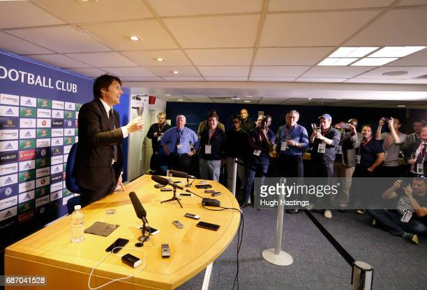 Chelsea's Antonio Conte raises a glass of champagne to the gathered media after the Premier League match between Chelsea and Sunderland at Stamford...