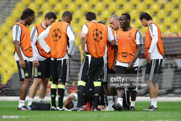 Chelsea's Ashley Cole after a challenge from Claude Makelele during a training session at the Luzhniki Stadium Moscow Russia