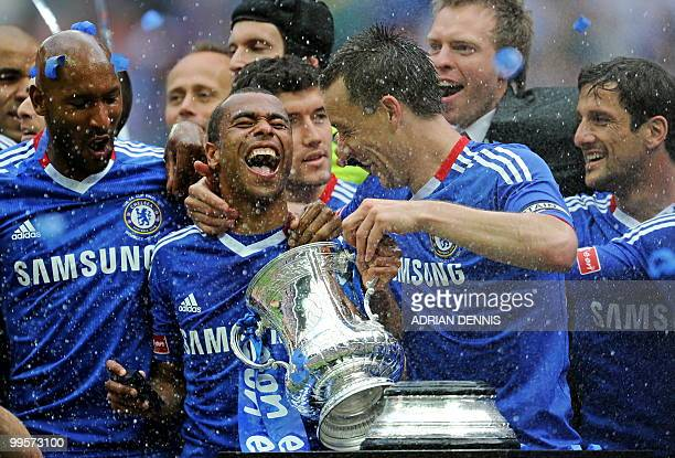 Chelsea's Ashley Cole and John Terry celebrate with the FA Cup after beating Portsmouth 10 during the FA Cup Final football match at Wembley in north...