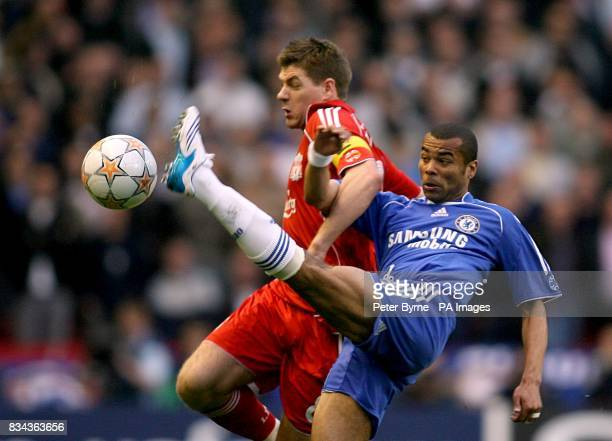 Chelsea's Ashley Cole and Liverpool's Steven Gerrard battle for the ball