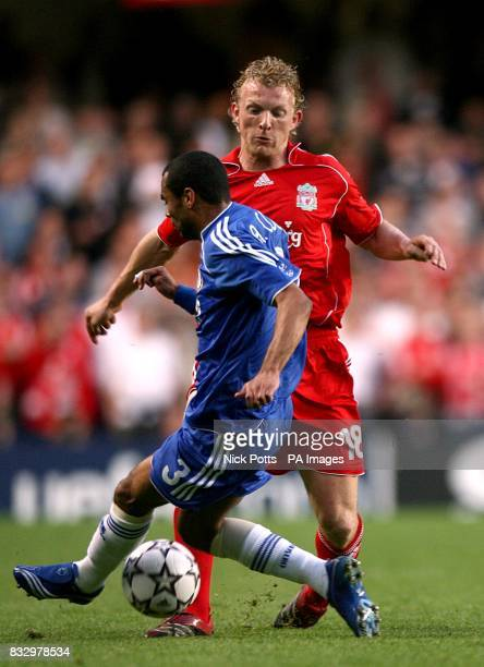 Chelsea's Ashley Cole challenges Liverpool's Dirk Kuyt
