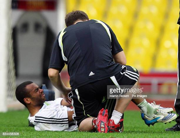 Chelsea's Ashley Cole in pain after a challenge from Claude Makelele during a training session at the Luzhniki Stadium Moscow Russia