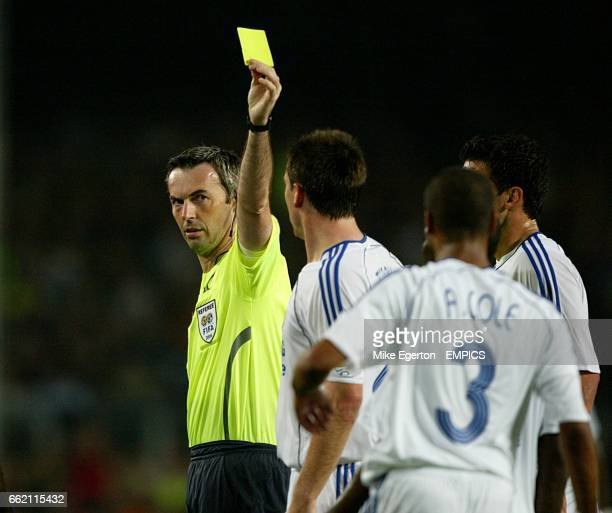Chelsea's Ashley Cole is booked by referee Stefano Farina
