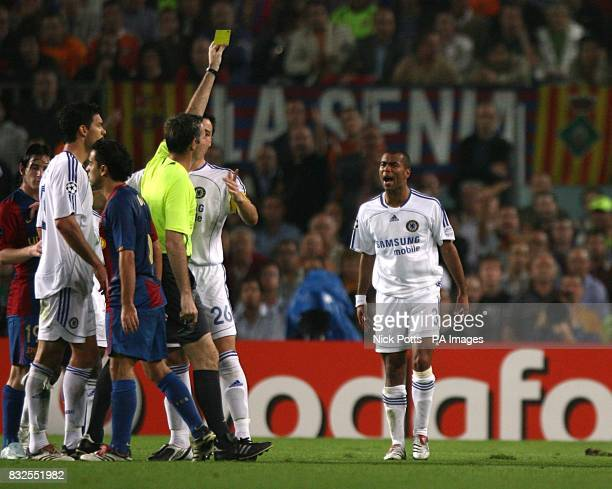 Chelsea's Ashley Cole is shown the yellow card by referee Stefano Farina