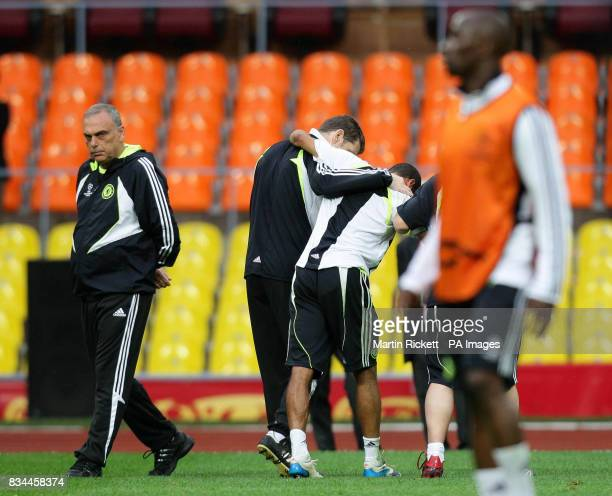 Chelsea's Ashley Cole leaves the pitch after a challenge from Claude Makelele during a training session at the Luzhniki Stadium Moscow Russia