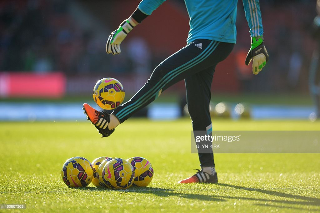 Chelsea's Australian goalkeeper <a gi-track='captionPersonalityLinkClicked' href=/galleries/search?phrase=Mark+Schwarzer&family=editorial&specificpeople=208085 ng-click='$event.stopPropagation()'>Mark Schwarzer</a> warms-up ahead of the English Premier League football match between Southampton and Chelsea at St Mary's Stadium in Southampton, southern England, on December 28, 2014. AFP PHOTO / GLYN KIRK USE. No use with unauthorized audio, video, data, fixture lists, club/league logos or live services. Online in-match use limited to 45 images, no video emulation. No use in betting, games or single club/league/player publications.