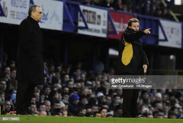 Chelsea's Avram Grant and Portsmouth's Harry Redknapp watch during the Barclay's Premier League match at Fratton Park Portsmouth