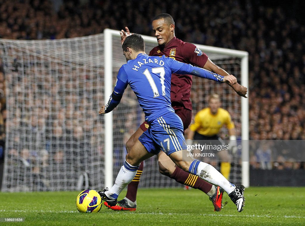 """Chelsea's Belgiam midfielder Eden Hazard (L) vies with Manchester City's Belgiam defender Vincent Kompany during the English Premier League football match between Chelsea and Manchester City at Stamford Bridge in London on November 25, 2012. USE. No use with unauthorized audio, video, data, fixture lists, club/league logos or """"live"""" services. Online in-match use limited to 45 images, no video emulation. No use in betting, games or single club/league/player publications"""