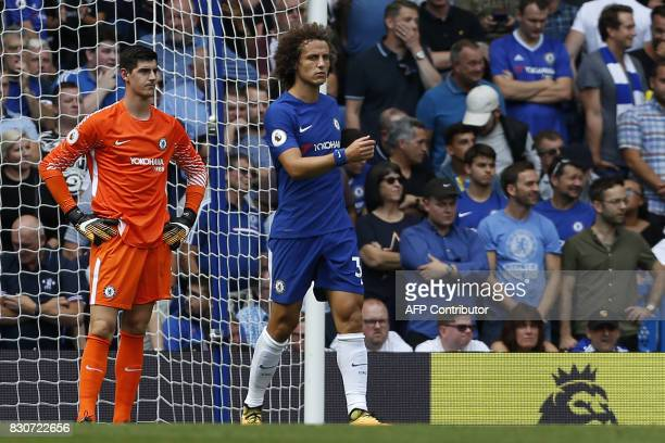 Chelsea's Belgian goalkeeper Thibaut Courtois and Chelsea's Brazilian defender David Luiz react after conceding their second goal during the English...