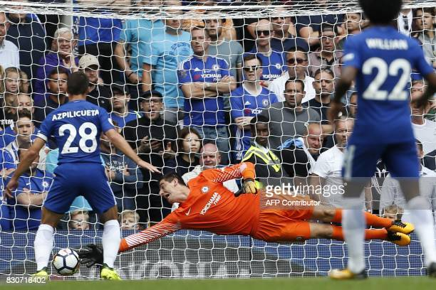 Chelsea's Belgian goalkeeper Thibaut Courtois cannot reach the ball as Burnley's Welsh striker Sam Vokes scores the opening goal of the English...
