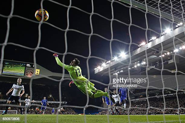 Chelsea's Belgian goalkeeper Thibaut Courtois cannot stop the header from Tottenham Hotspur's English midfielder Dele Alli as Tottenham take the lead...