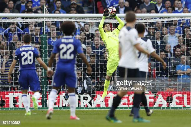 Chelsea's Belgian goalkeeper Thibaut Courtois catches the ball during the FA Cup semifinal football match between Tottenham Hotspur and Chelsea at...