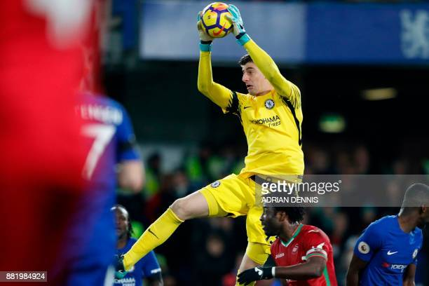 Chelsea's Belgian goalkeeper Thibaut Courtois catches the ball during the English Premier League football match between Chelsea and Swansea City at...