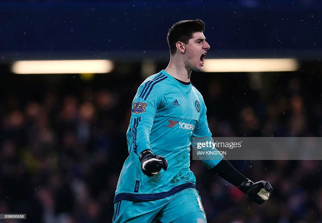 Chelsea's Belgian goalkeeper Thibaut Courtois celebrates after Chelsea's Brazilian-born Spanish striker Diego Costa scored during the English Premier League football match between Chelsea and Manchester United at Stamford Bridge in London on February 7, 2016. / AFP / Ian Kington / RESTRICTED TO EDITORIAL USE. No use with unauthorized audio, video, data, fixture lists, club/league logos or 'live' services. Online in-match use limited to 75 images, no video emulation. No use in betting, games or single club/league/player publications. /