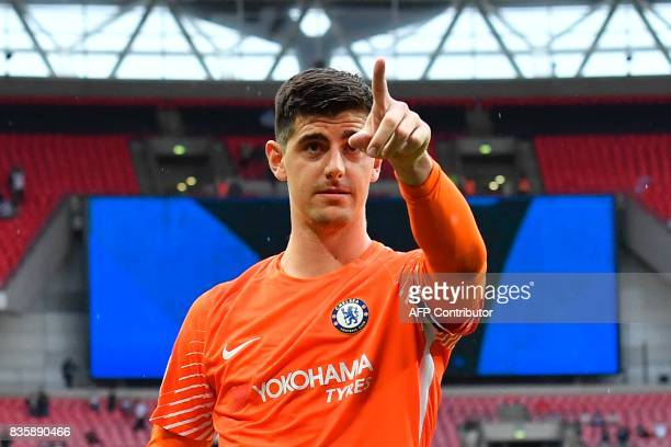 Chelsea's Belgian goalkeeper Thibaut Courtois celebrates victory during the English Premier League football match between Tottenham Hotspur and...