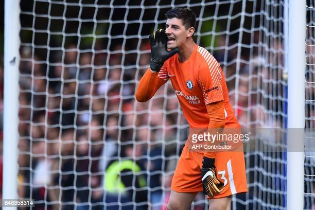 Chelsea's Belgian goalkeeper Thibaut Courtois gestures during the English Premier League football match between Chelsea and Arsenal at Stamford...