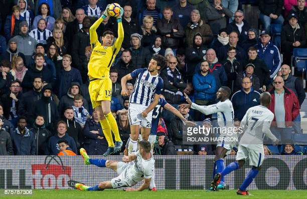 TOPSHOT Chelsea's Belgian goalkeeper Thibaut Courtois jumps to catch a ball during the English Premier League football match between West Bromwich...