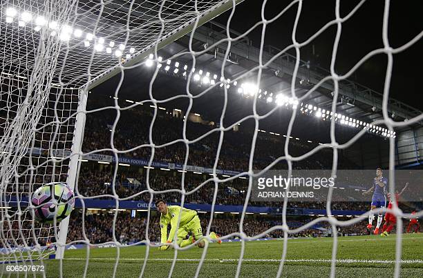 Chelsea's Belgian goalkeeper Thibaut Courtois reacts after failing to save a shot from Liverpool's English midfielder Jordan Henderson during the...