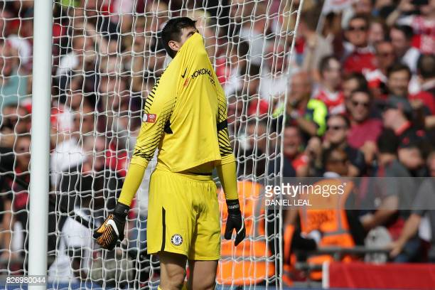 TOPSHOT Chelsea's Belgian goalkeeper Thibaut Courtois reacts to conceding a goal during the shootout during the English FA Community Shield football...