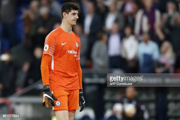 Chelsea's Belgian goalkeeper Thibaut Courtois reacts to their defeat on the pitch after the English Premier League football match between Crystal...