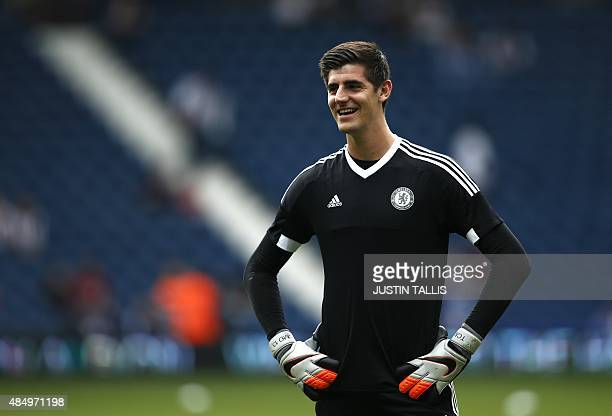 Chelsea's Belgian goalkeeper Thibaut Courtois smiles as he warms up ahead of the English Premier League football match between West Bromwich Albion...