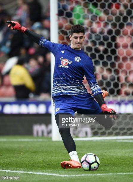 Chelsea's Belgian goalkeeper Thibaut Courtois warms up before the English Premier League football match between Stoke City and Chelsea at the Bet365...