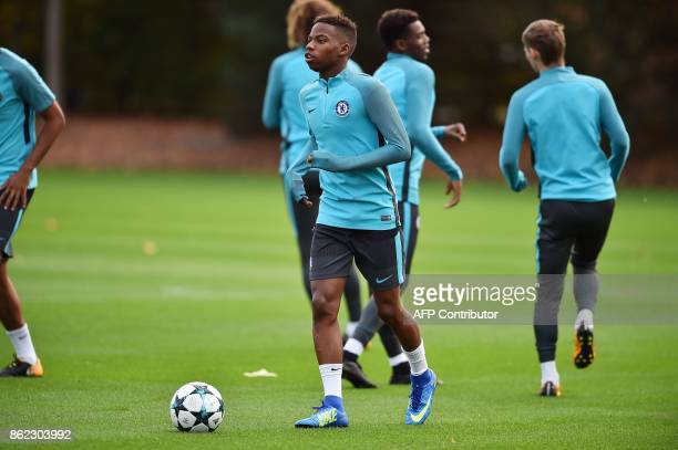 Chelsea's Belgian midfielder Charly Musonda runs with the ball during a team training session at Chelsea's Cobham training facility in Stoke...