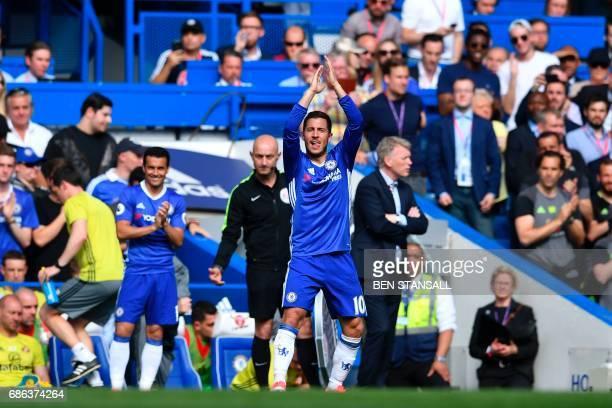 Chelsea's Belgian midfielder Eden Hazard applauds as he is substituted during the English Premier League football match between Chelsea and...