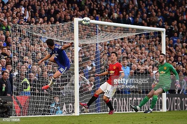 Chelsea's Belgian midfielder Eden Hazard attempts an acrobatic shot as Manchester United's Spanish goalkeeper David de Gea and Manchester United's...