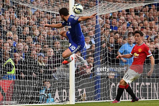 Chelsea's Belgian midfielder Eden Hazard attempts an acrobatic shot as Manchester United's Spanish midfielder Ander Herrera covers the line as the...