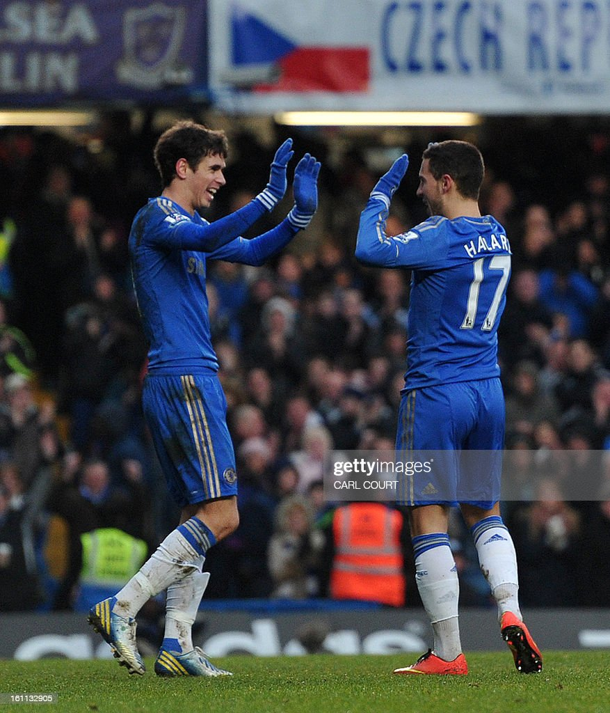 Chelsea's Belgian midfielder Eden Hazard (R) celebrates after scoring Chelsea's second goal during the English Premier League football match between Chelsea and Wigan Athletic at Stamford Bridge in London on February 9, 2013. USE. No use with unauthorized audio, video, data, fixture lists, club/league logos or 'live' services. Online in-match use limited to 45 images, no video emulation. No use in betting, games or single club/league/player publications.