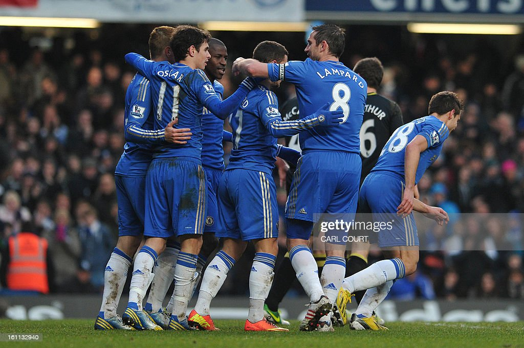 Chelsea's Belgian midfielder Eden Hazard (C) celebrates after scoring Chelsea's second goal with teammates during the English Premier League football match between Chelsea and Wigan Athletic at Stamford Bridge in London on February 9, 2013. USE. No use with unauthorized audio, video, data, fixture lists, club/league logos or 'live' services. Online in-match use limited to 45 images, no video emulation. No use in betting, games or single club/league/player publications.