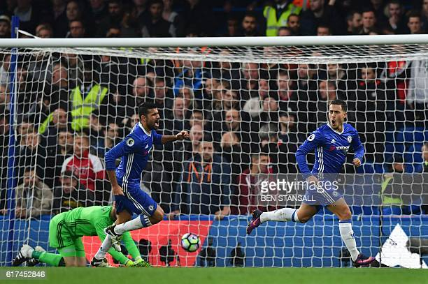 Chelsea's Belgian midfielder Eden Hazard celebrates after scoring their third goal during the English Premier League football match between Chelsea...