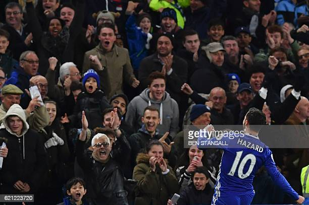 Chelsea's Belgian midfielder Eden Hazard celebrates after scoring the opening goal of the English Premier League football match between Chelsea and...