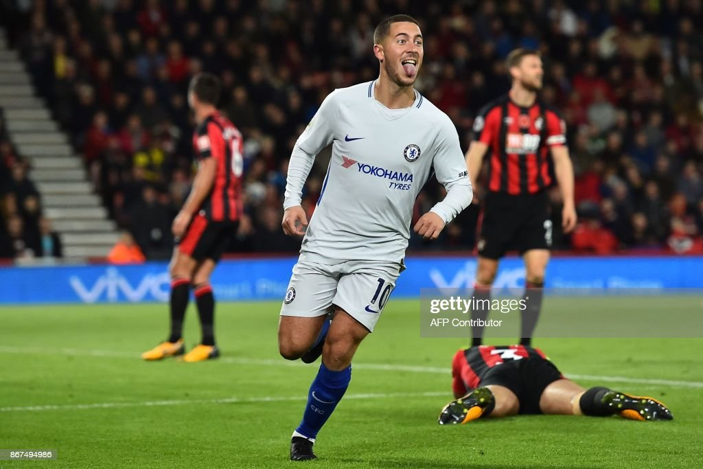 Chelsea's Belgian midfielder Eden Hazard celebrates after scoring the opening goal of the English Premier League football match between Bournemouth and Chelsea at the Vitality Stadium in Bournemouth, southern England on October 28, 2017. / AFP PHOTO / Glyn KIRK / RESTRICTED TO EDITORIAL USE. No use with unauthorized audio, video, data, fixture lists, club/league logos or 'live' services. Online in-match use limited to 75 images, no video emulation. No use in betting, games or single club/league/player publications. /