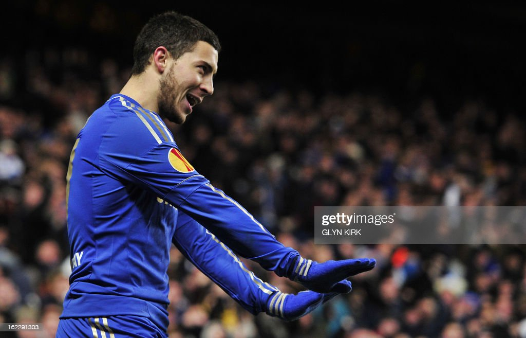 Chelsea's Belgian midfielder Eden Hazard celebrates scoring his late goal during the second leg of the UEFA Europa League round of 32 football match between Chelsea and Sparta Prague in London on February 21, 2013. The game finished 1-1, Chelsea winning the tie 2-1. AFP PHOTO/GLYN KIRK