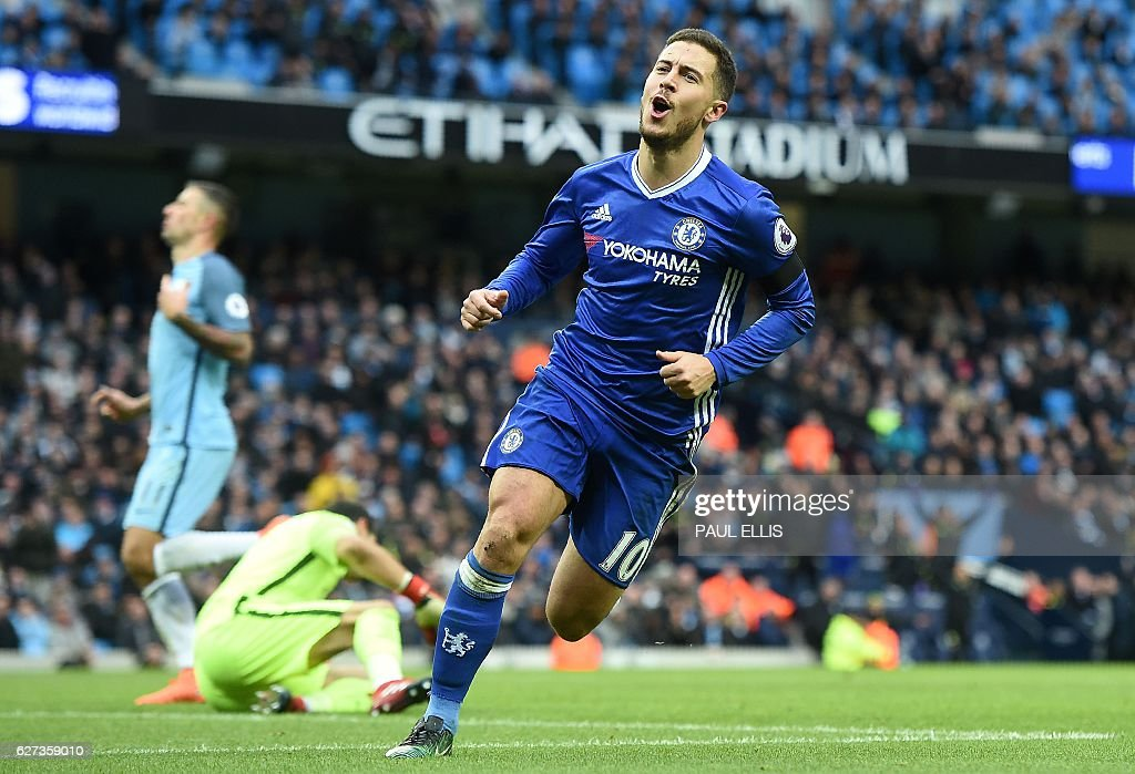 Chelsea's Belgian midfielder Eden Hazard celebrates scoring his team's third goal during the English Premier League football match between Manchester City and Chelsea at the Etihad Stadium in Manchester, north west England, on December 3, 2016. / AFP / Paul ELLIS / RESTRICTED TO EDITORIAL USE. No use with unauthorized audio, video, data, fixture lists, club/league logos or 'live' services. Online in-match use limited to 75 images, no video emulation. No use in betting, games or single club/league/player publications. /