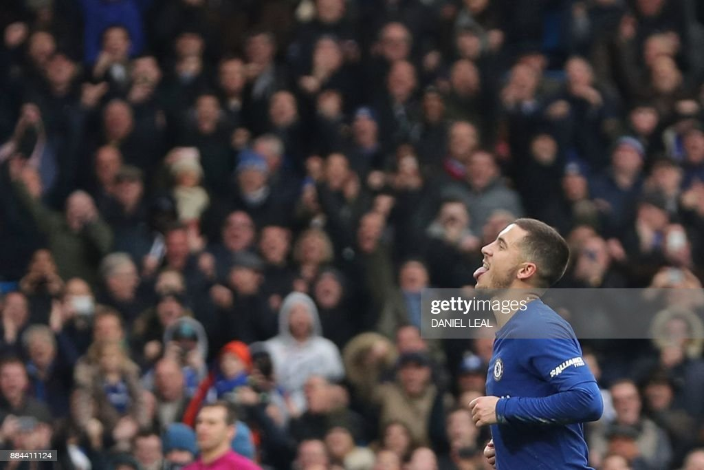 Chelsea's Belgian midfielder Eden Hazard celebrates scoring his team's third goal, and his second goal, from the penalty spot during the English Premier League football match between Chelsea and Newcastle United at Stamford Bridge in London on December 2, 2017. / AFP PHOTO / Daniel LEAL-OLIVAS / RESTRICTED TO EDITORIAL USE. No use with unauthorized audio, video, data, fixture lists, club/league logos or 'live' services. Online in-match use limited to 75 images, no video emulation. No use in betting, games or single club/league/player publications. /