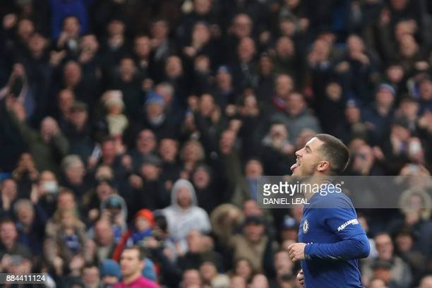 Chelsea's Belgian midfielder Eden Hazard celebrates scoring his team's third goal and his second goal from the penalty spot during the English...