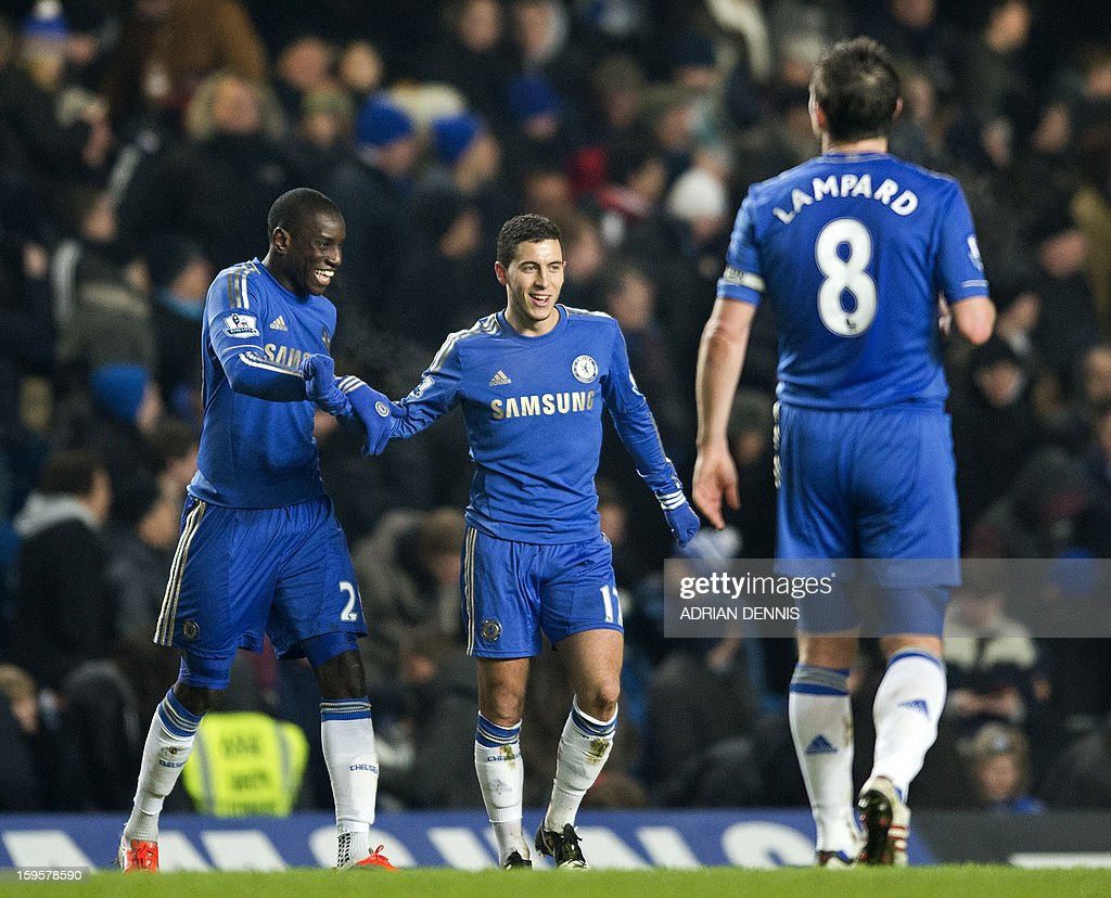 """Chelsea's Belgian midfielder Eden Hazard (2nd L) celebrates scoring the second goal with French-born Senegalese striker Demba Ba (L) during the English Premier League football match between Chelsea and Southampton at Stamford Bridge in London, on January 16, 2013. USE. No use with unauthorized audio, video, data, fixture lists, club/league logos or """"live"""" services. Online in-match use limited to 45 images, no video emulation. No use in betting, games or single club/league/player publications."""