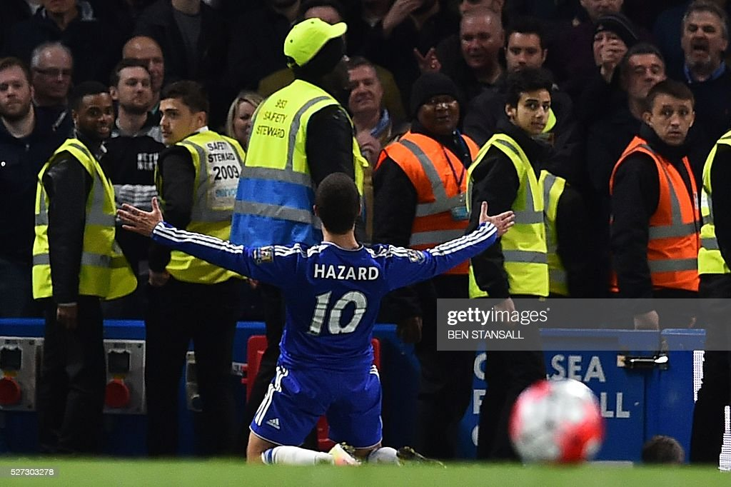 Chelsea's Belgian midfielder Eden Hazard celebrates scoring their second goal to level the score at 2-2 during the English Premier League football match between Chelsea and Tottenham Hotspur at Stamford Bridge in London on May 2, 2016. / AFP / BEN STANSALL / RESTRICTED TO EDITORIAL USE. No use with unauthorized audio, video, data, fixture lists, club/league logos or 'live' services. Online in-match use limited to 75 images, no video emulation. No use in betting, games or single club/league/player publications. /