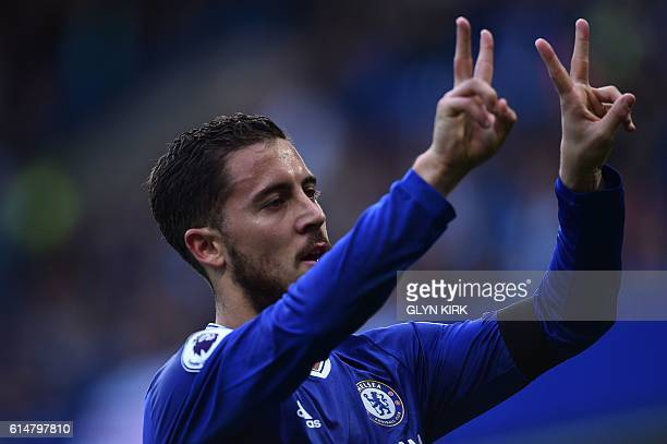 Chelsea's Belgian midfielder Eden Hazard celebrates with a gesture in support of Willian who's mother passed away recently after scoring Chelsea's...