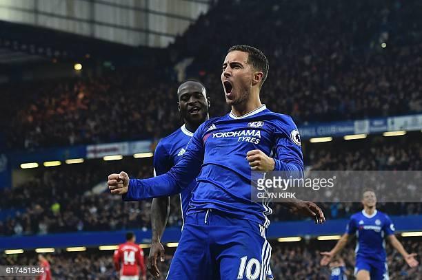 Chelsea's Belgian midfielder Eden Hazard celebrates with Chelsea's Nigerian midfielder Victor Moses after scoring their third goal during the English...