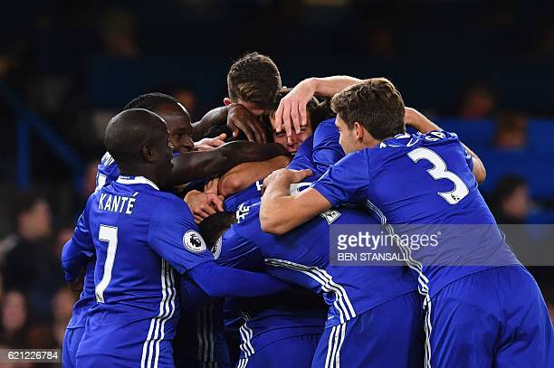 Chelsea's Belgian midfielder Eden Hazard celebrates with teammates after scoring their fourth goal during the English Premier League football match...