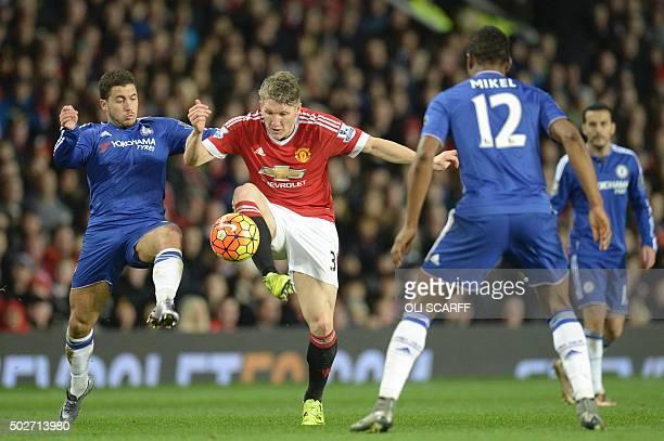 Chelsea's Belgian midfielder Eden Hazard challenges Manchester United's German midfielder Bastian Schweinsteiger during the English Premier League...